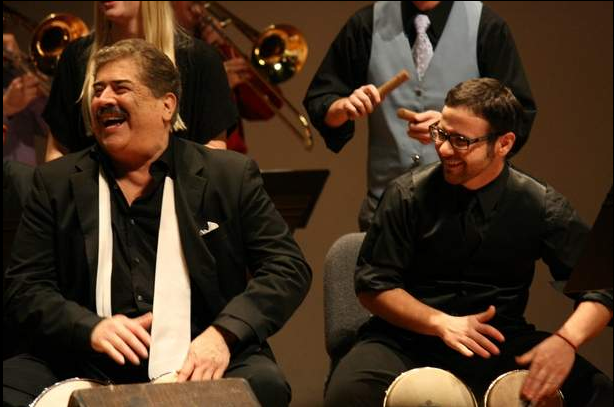 Mambo Legends Orchestra director and bongo player Johnny Rodriguez, left, and Crane Latin Ensemble bongo player Matt Christy.