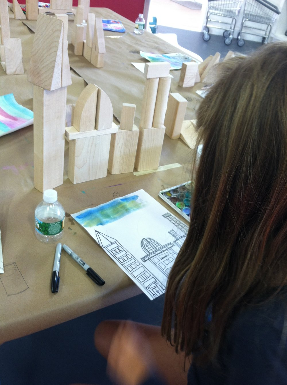 Students working on observational architectural drawings.