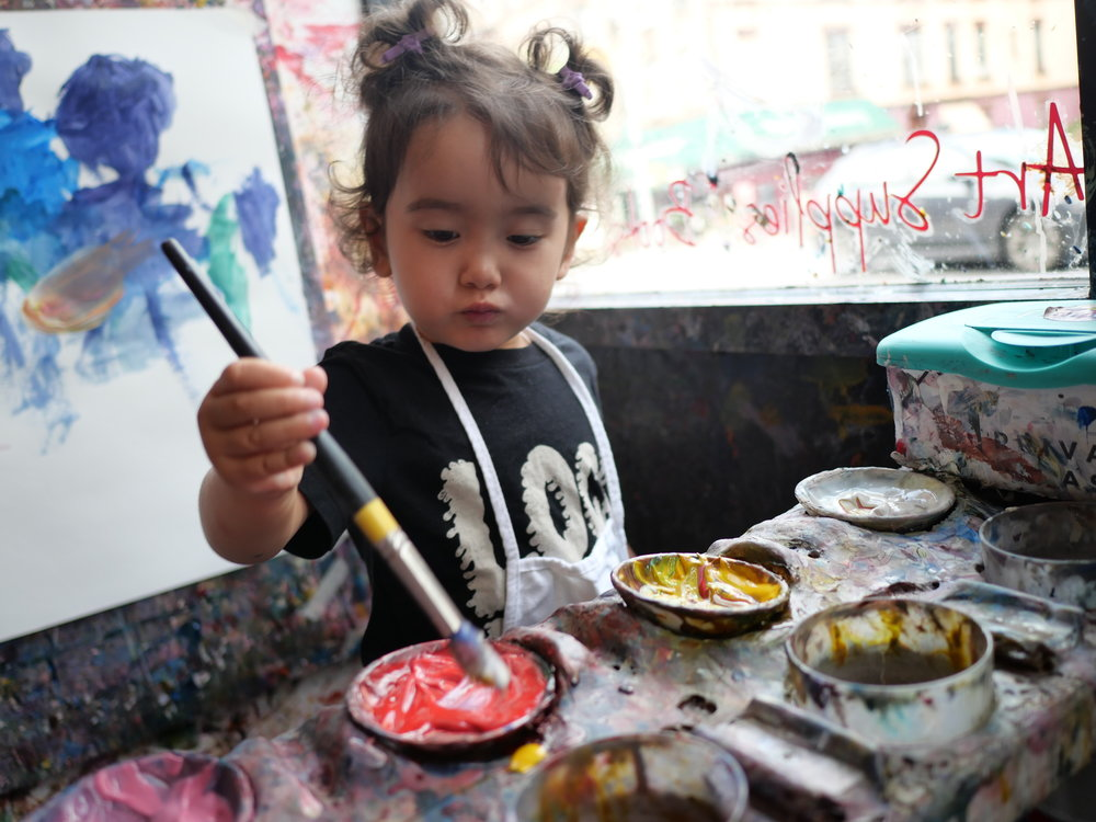 Toddler painting at our palette