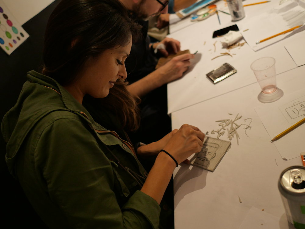 students carving for printmaking