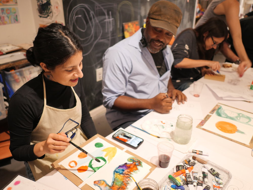 Adult students in a Watercolor Workshop at our Studio.