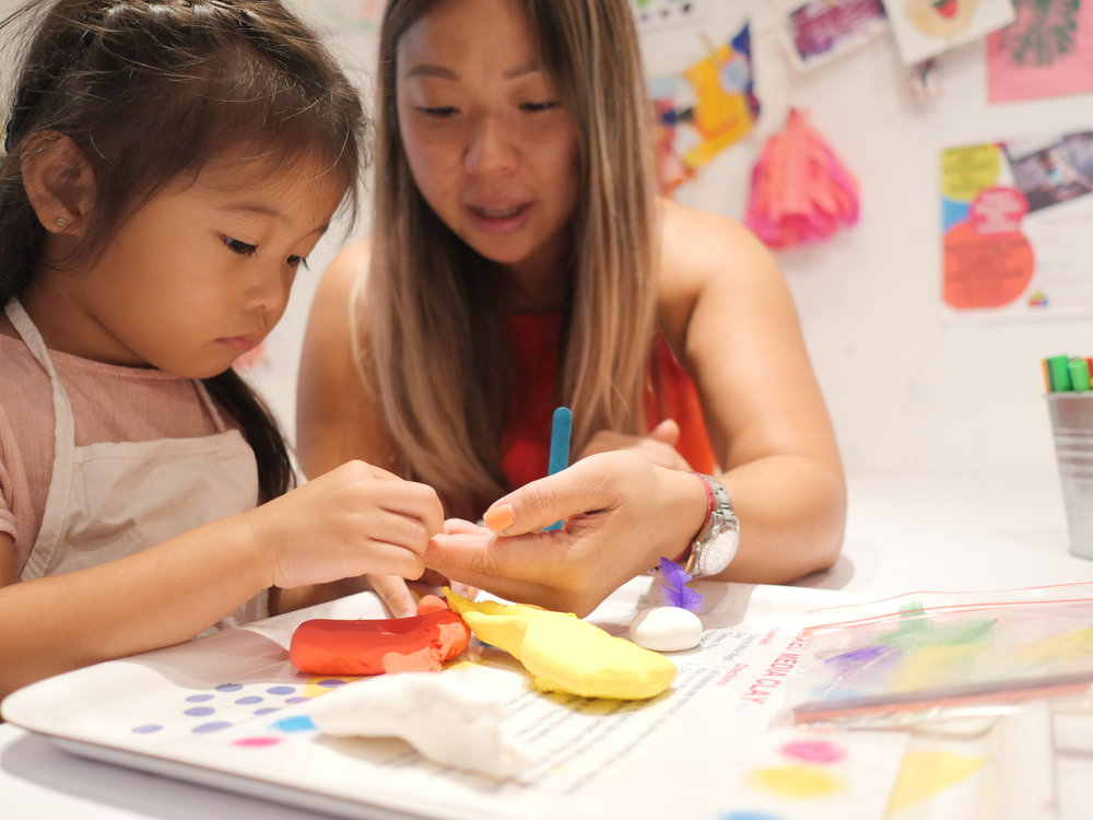 mom and daughter making art