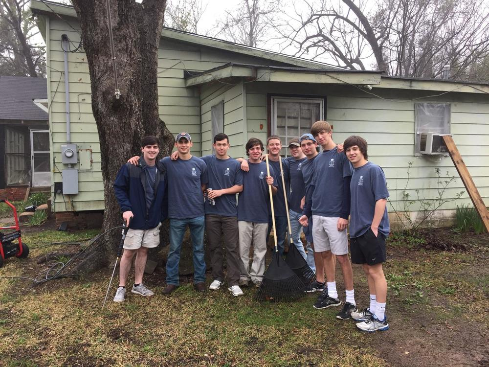 Brothers participate in the Big Event sponsored by Auburn University to help make improvements to the community.
