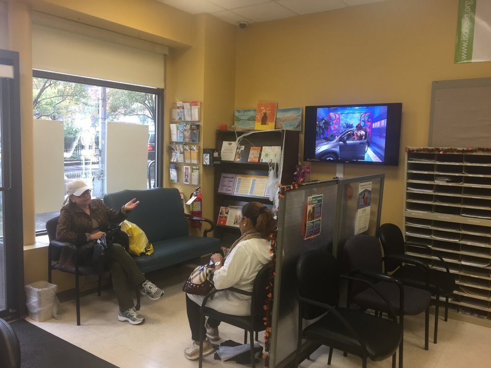 Senior clients chat in the waiting area at the Isabella Senior Service Center in Washington Heights. (Photo: Emily Dugdale).