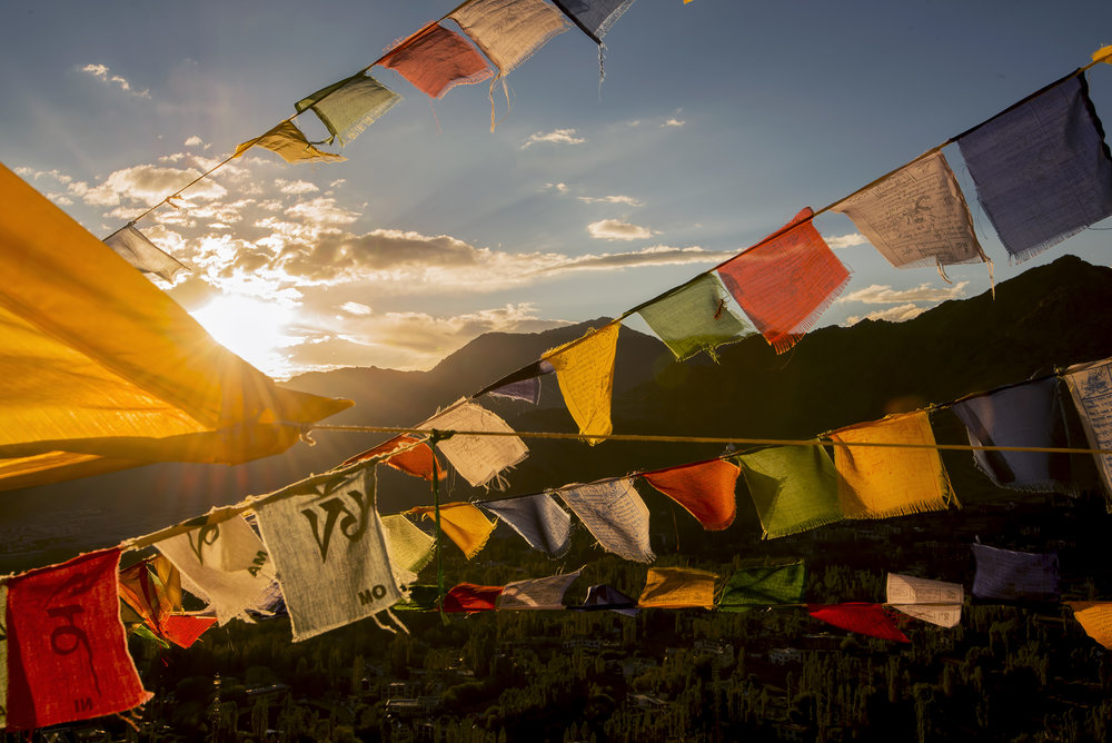 """Traditionally, prayer flags are used to promote peace, compassion, strength, and wisdom. The flags do not carry prayers to gods, which is a common misconception; rather, the Tibetans believe the prayers and mantras will be blown by the wind to spread the good will and compassion into all pervading space."""