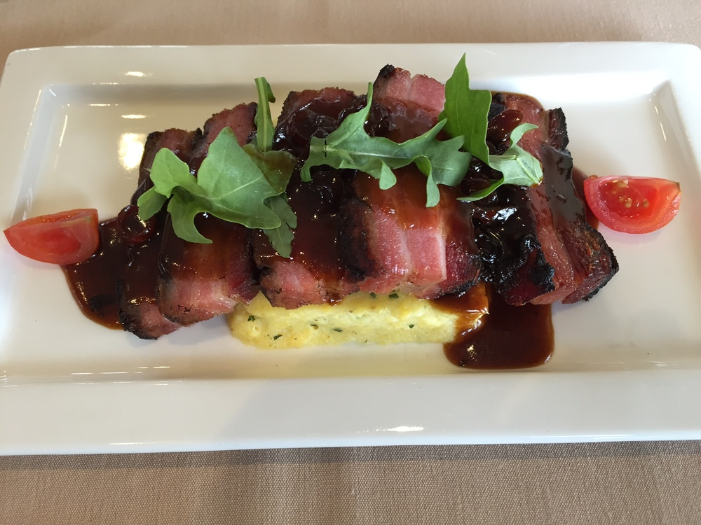 Braised Pork Belly w. Creamy Polenta, Cranberry Sauce and Arugula