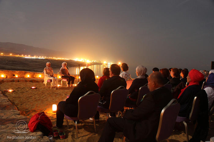 Mediation trainers Nesreen Khashman and Aseel Nassar lead the supermoon mediation beside the Dead Sea.