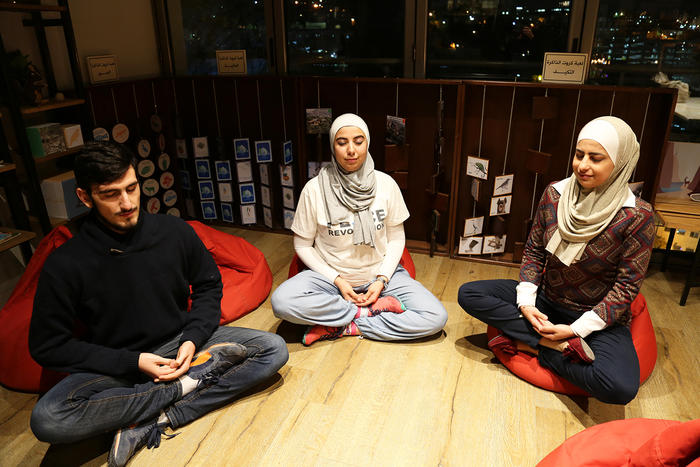 Meditator, Fares Akasheh and mediation trainers, Nesreen Khashman and Aseel Nassar (L to R).