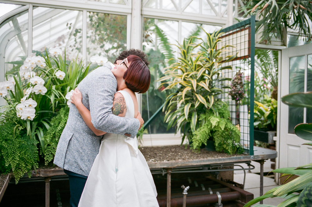 The first look from a Volunteer Park Conservatory elopement in Seattle, Washington.