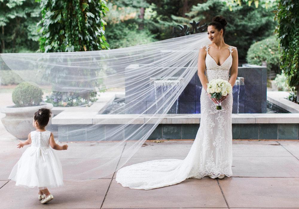 bride and long veil before wedding.jpg