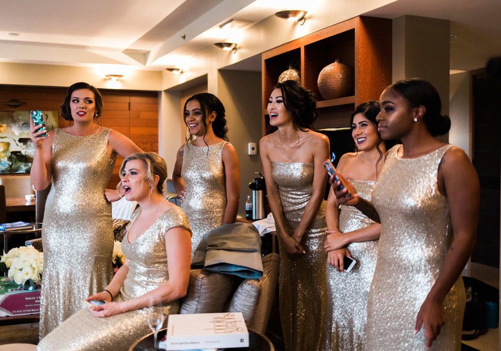 bridesmaids in gold dresses before a wedding.jpg