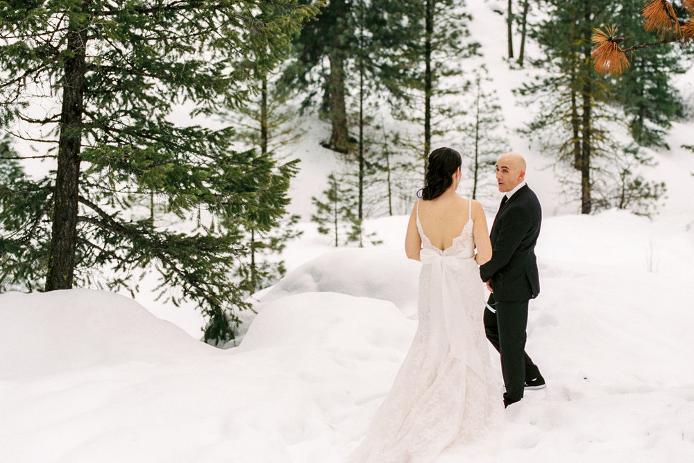 Sleeping Lady Mountain Resort in Leavenworth Winter wedding photography first look with the bride and groom