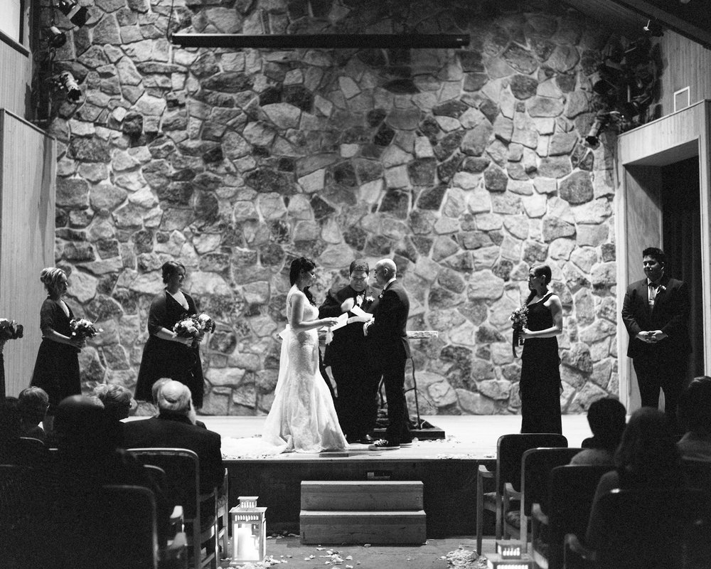 Sleeping Lady Mountain Resort in Leavenworth Winter wedding ceremony photography in the Salmon Gallery