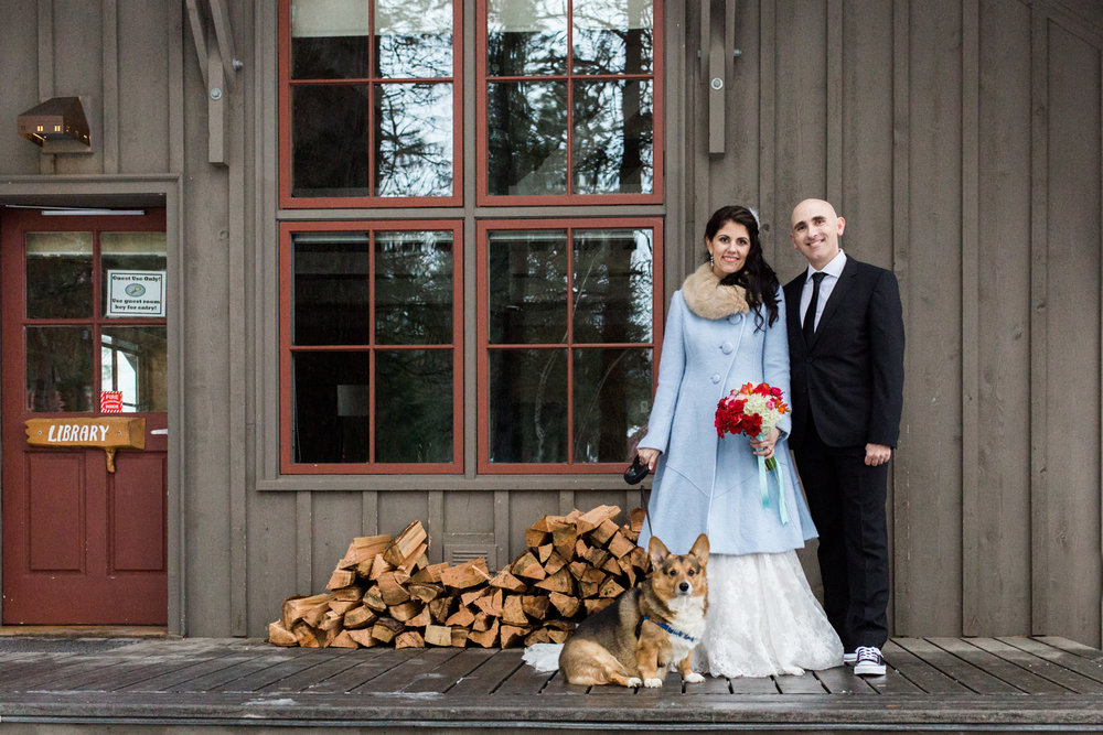 Couple with their corgi at the Sleeping Lady Mountain Resort in Leavenworth Winter wedding photography