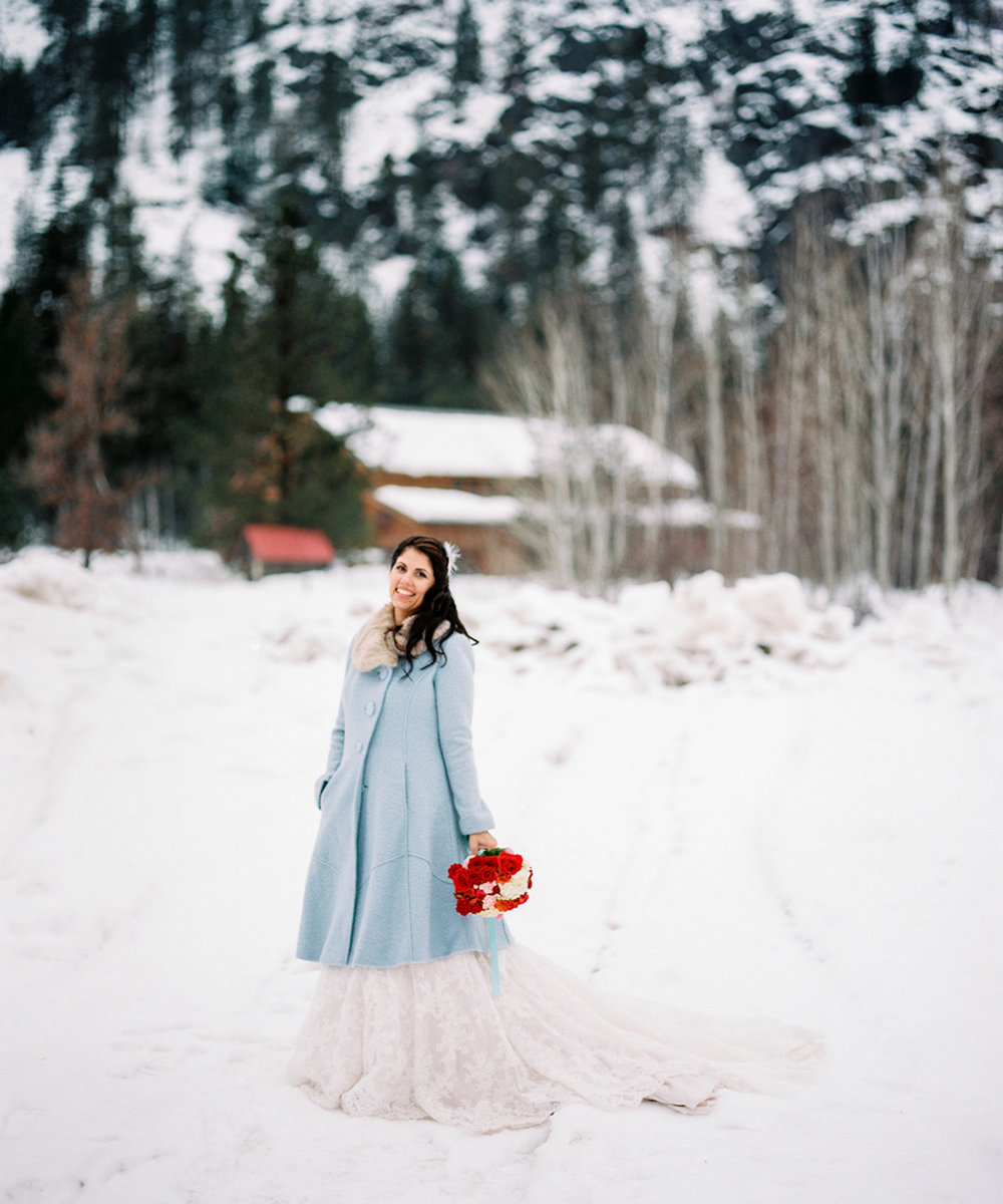 Sleeping Lady Mountain Resort in Leavenworth Winter wedding photography with a baby blue pea coat
