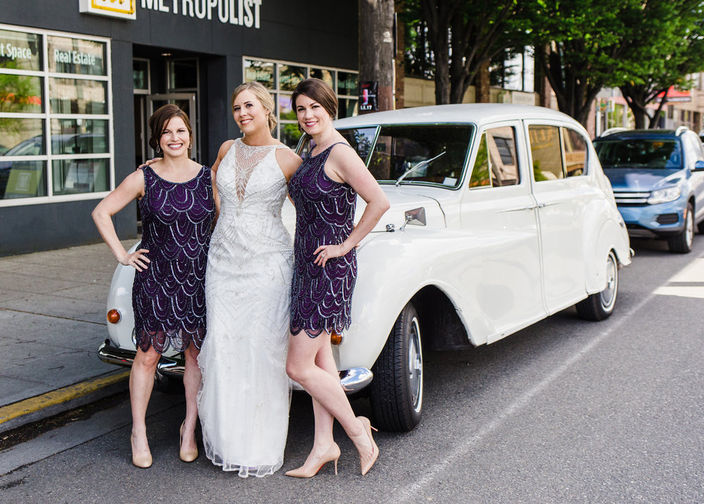 Bride and Bridesmaids with British Motor Coach Vintage Car by Alexandra Knight Photography Seattle Wedding Photographer