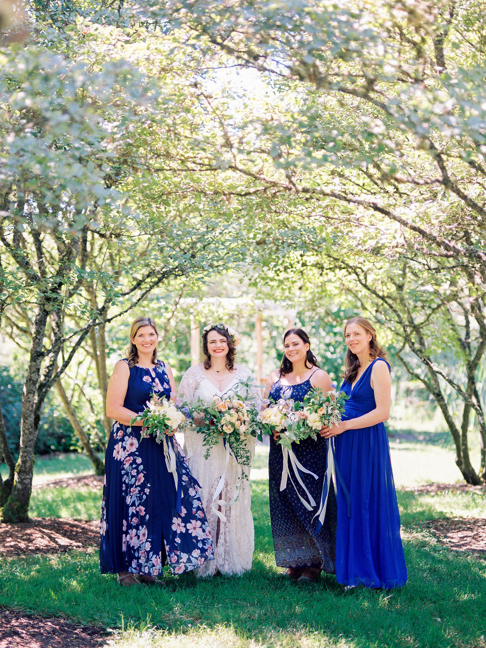 Bridesmaids in mismatched blue dresses Seattle University of Washington wedding