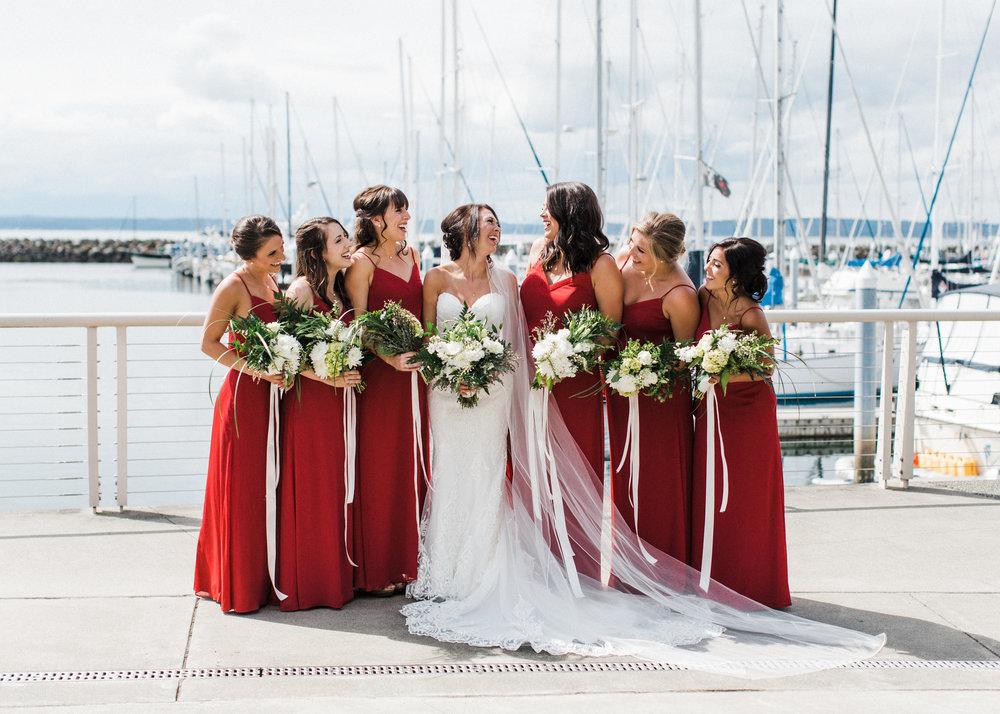 Bride and bridesmaids at shilshole bay marina in ballard Seattle Alexandra Knight Photography