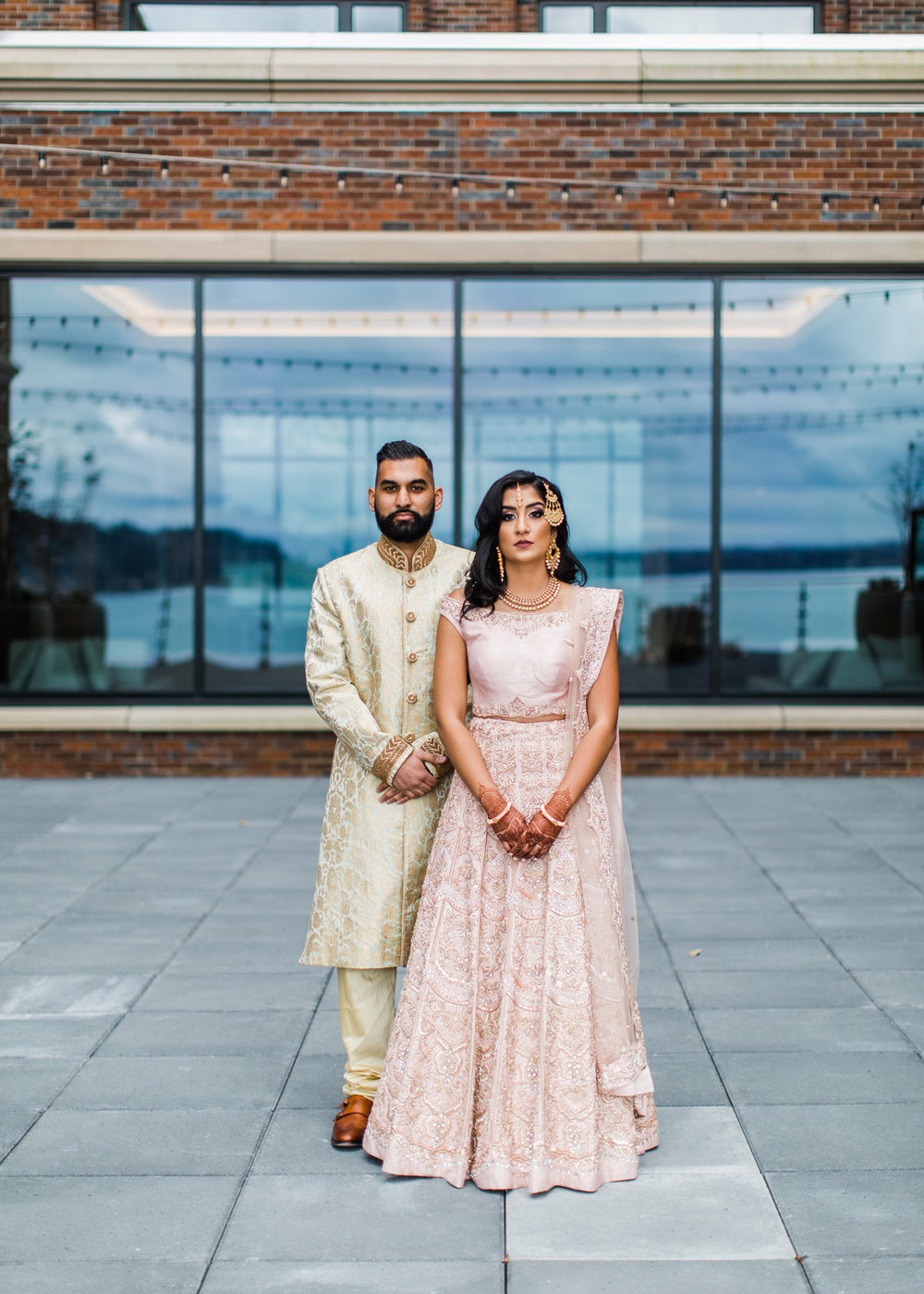 Alexandra Knight Photography Seattle Indian Wedding Photographer bride and groom in blush and gold wedding garments lehenga.jpg
