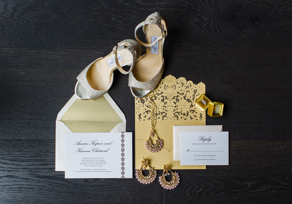 Alexandra Knight Photography gold glitter wedding invitation and jimmy choo shoes.jpg