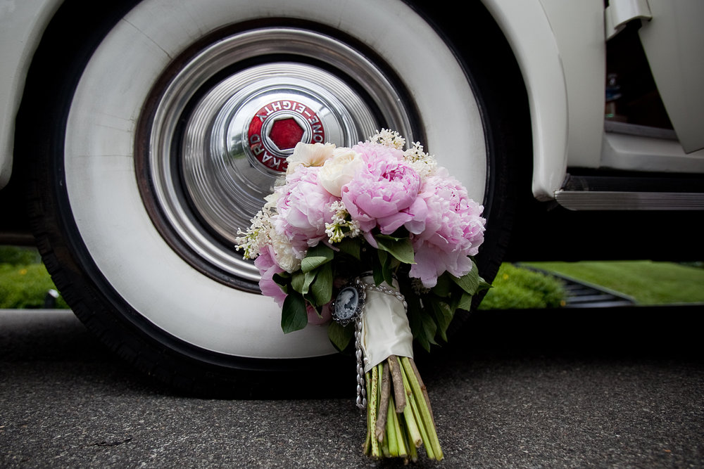 01.30.13 Packard at Farmington, Looney with bouquet on tire.jpg