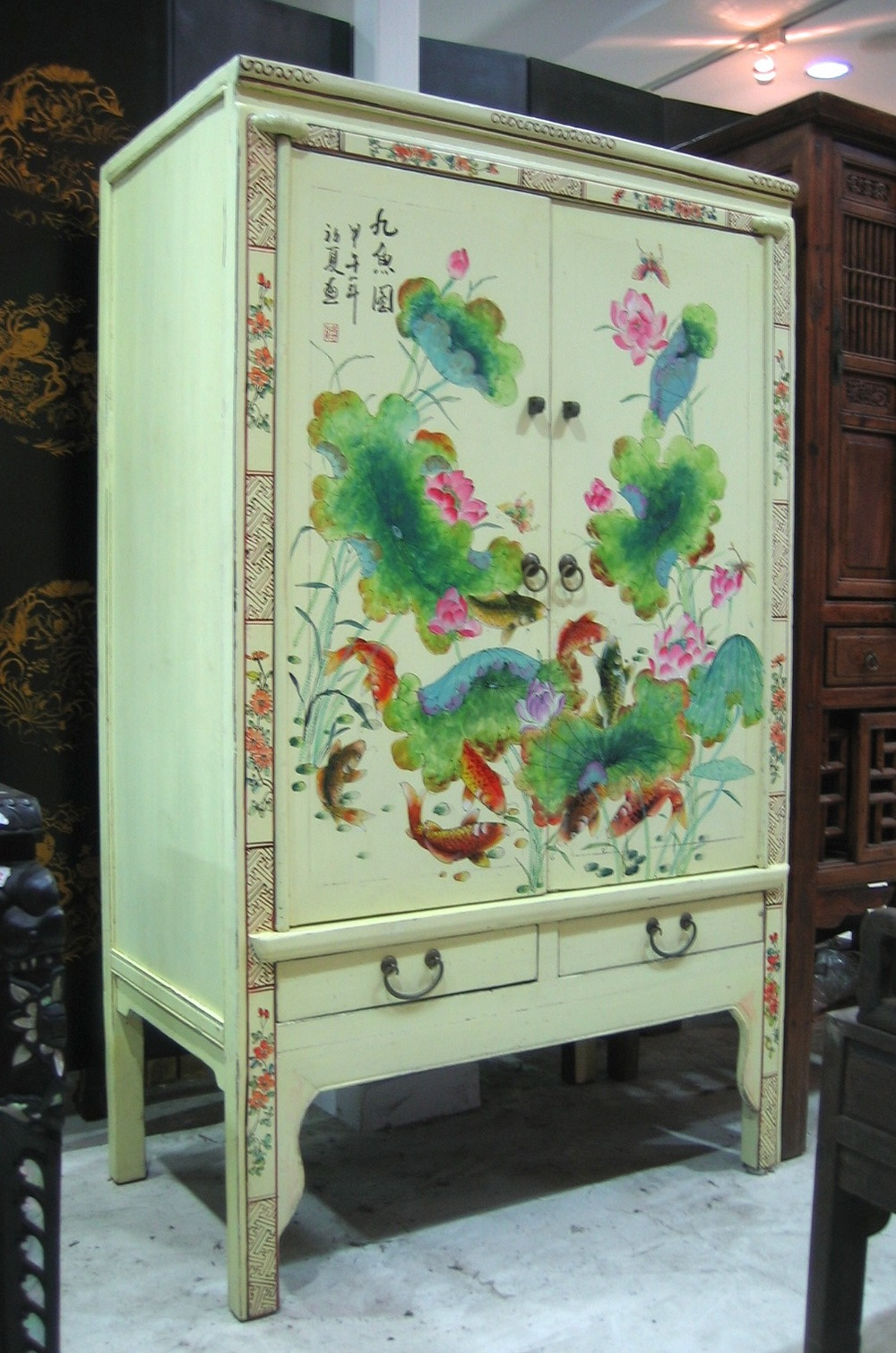 Light yellow cabinet with painting of nine fishes, meaning to always have abundance in everything. Now on sale at S$800.00. SOLD.
