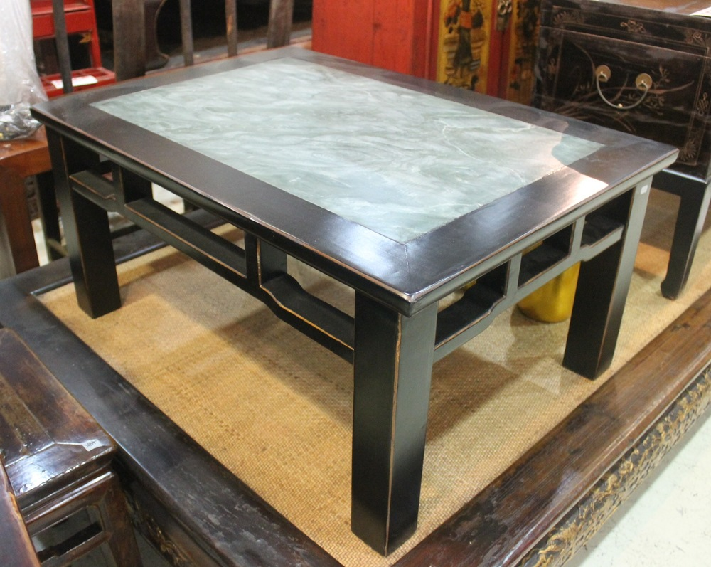 An Elm wood coffee table in black finish and a green stone top. L100 x W70 x H47cm. Was S$1,200, now on sale at S$400.00 only! SOLD.