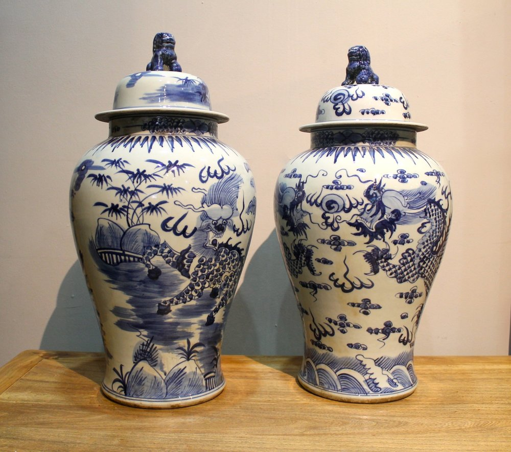 Blue & white tall porcelain jars, featuring kirins and dragons.