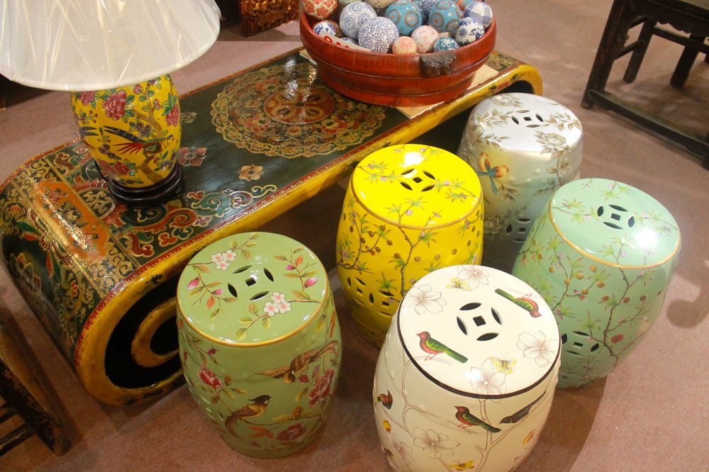 Tibetan-style scroll table; ceramic stools with painting