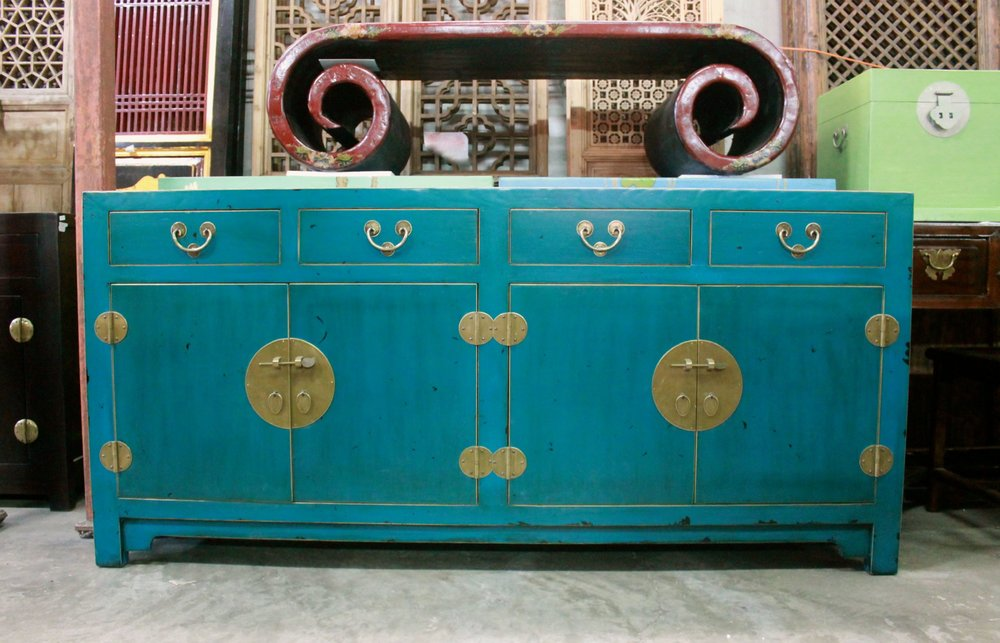 Long sideboard in dark sea green. Also available in cool grey, jade, red, dirty white, black & canary yellow.