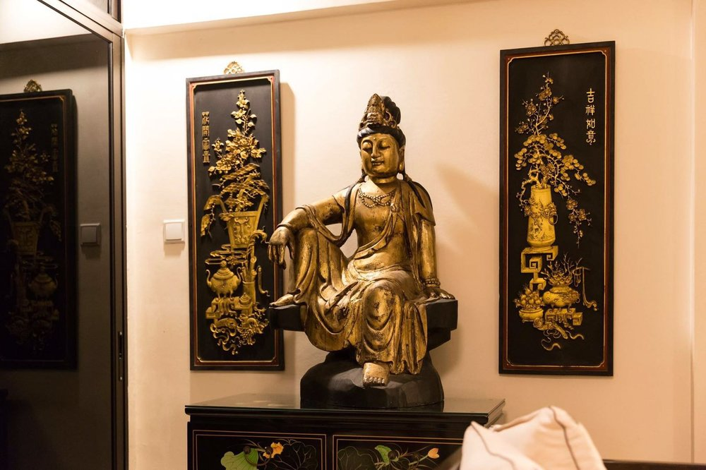 Wooden Guan Yin statue. Styling & photo courtesy of Andy Choi.