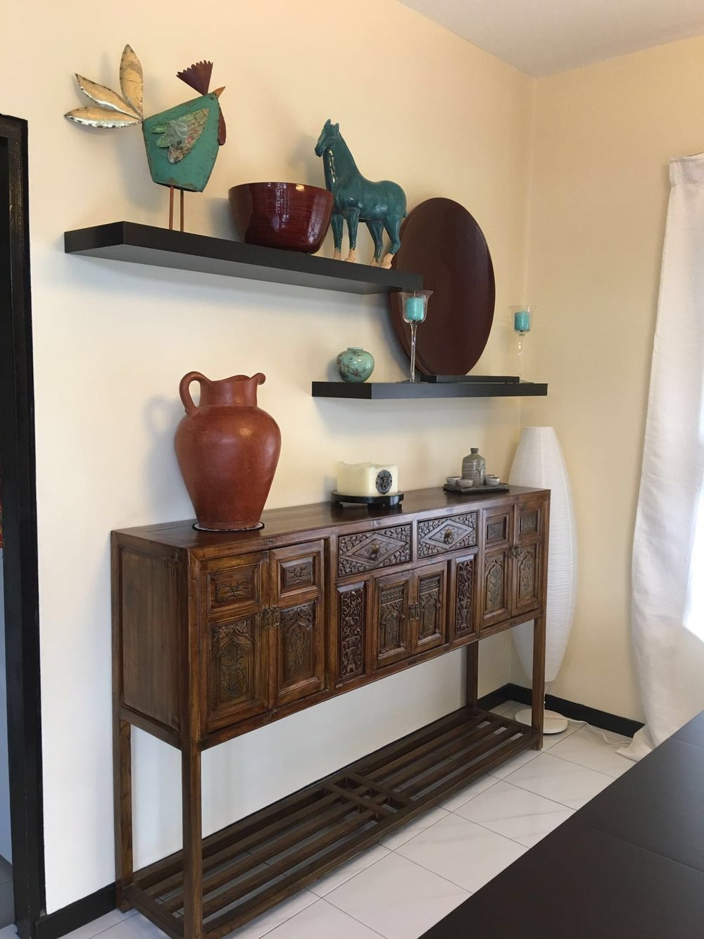 An old carved slim console from Fujian province. Styling & photo courtesy of Sally L.