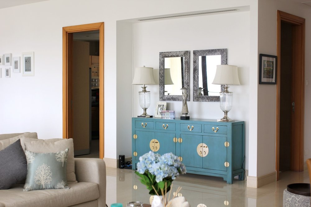 Living room console in aqua. Styling & photo courtesy of Arete Culture.