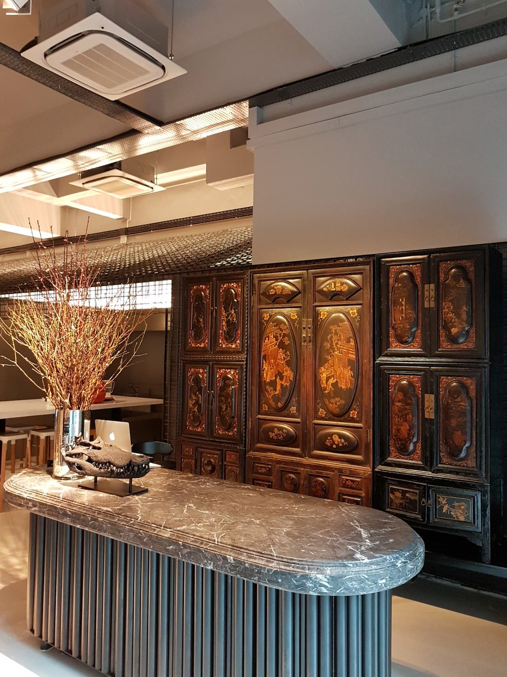 Antique lacquered cabinets from Chaozhou. Corporate office, styling and photo courtesy of eco-id architects Singapore.