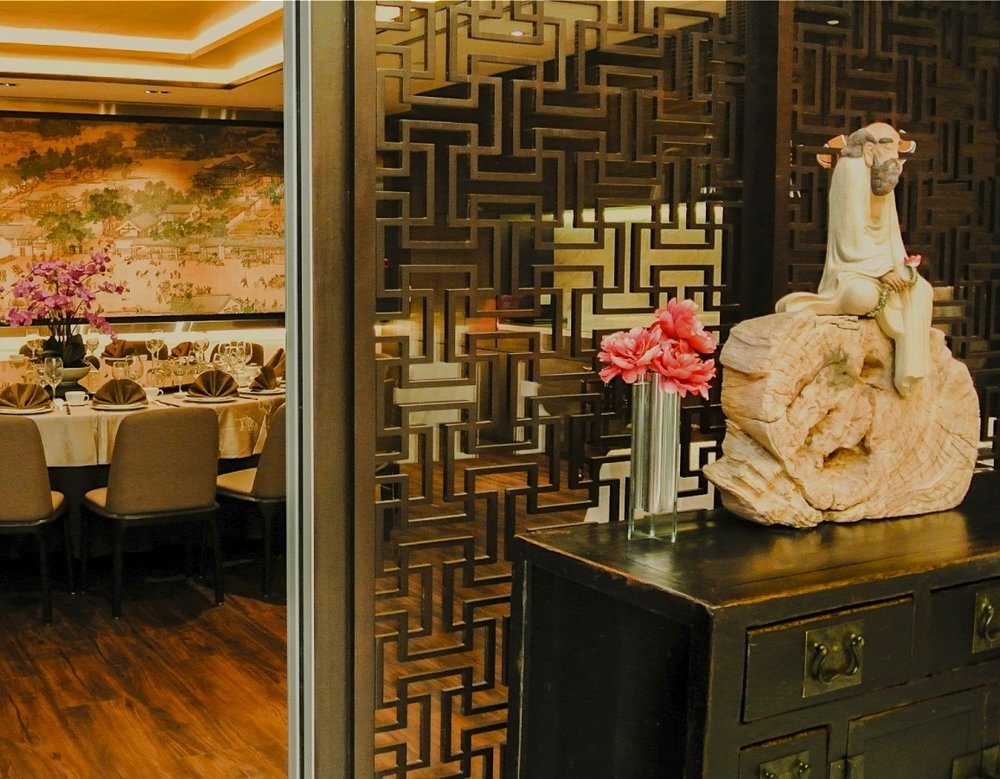 Right: Antique Tianjin sideboard & ceramic sculpture on wooden block. Photo from www.kaigarden.com.sg
