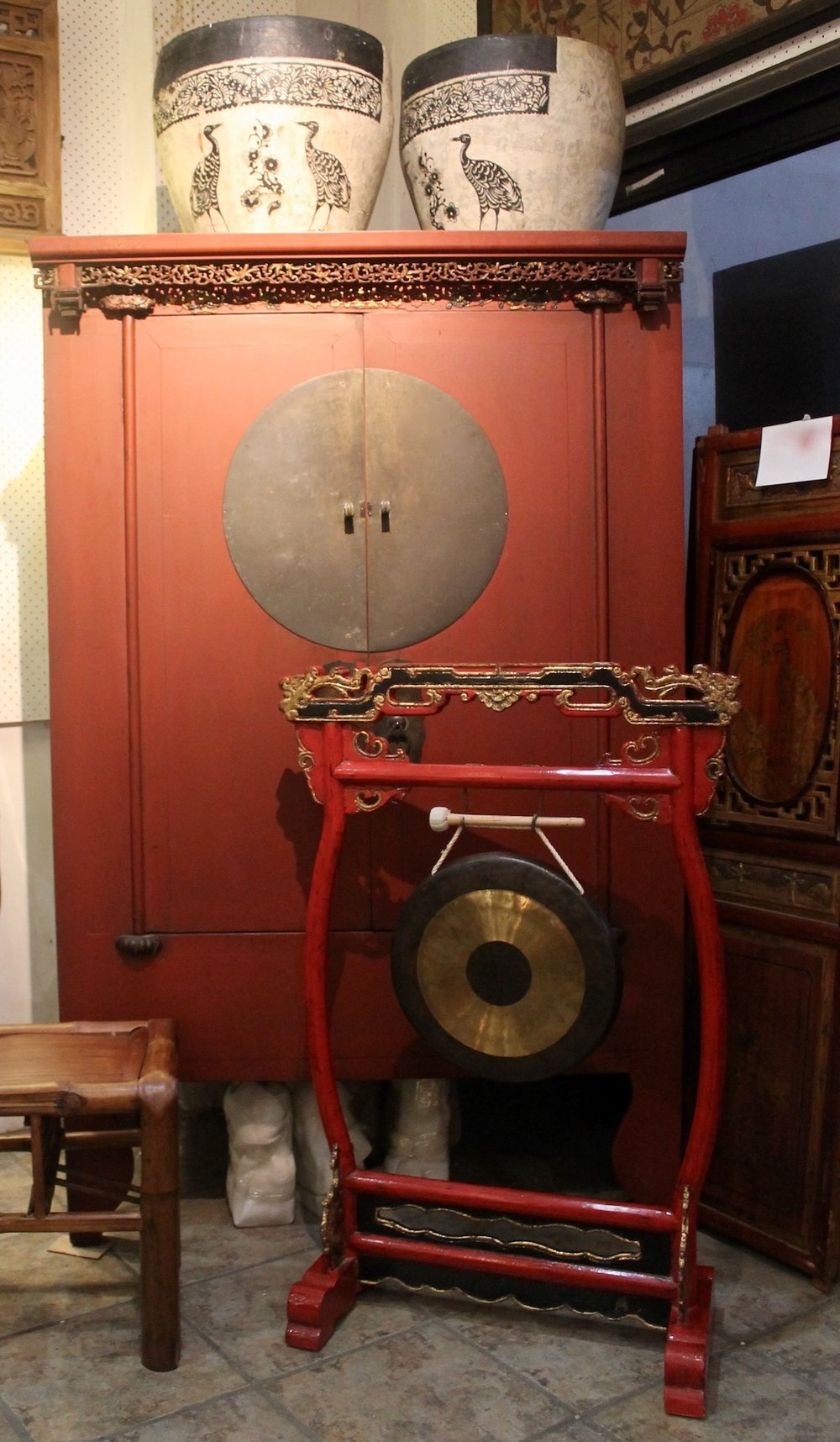 Main: Antique red & gold wedding cabinet with carving. Left: bamboo stool; right: Gong with stand (reproduction).