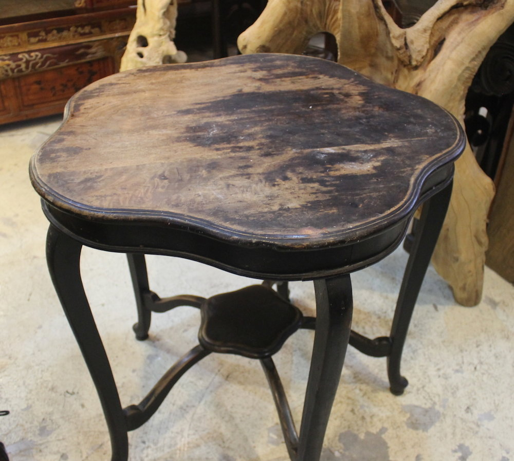 A vintage cherry blossom-shaped table with curved legs.