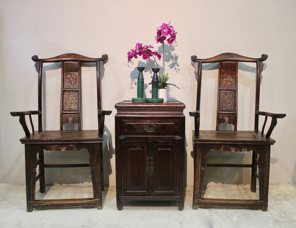 A pair of antique highback chairs from Shanxi; middle: a vintage cabinet from Zhejiang.