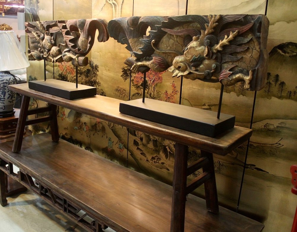 Old dragon carvings and long benches