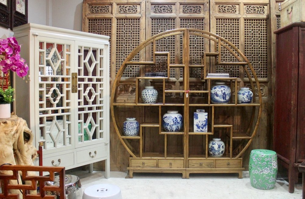 """Left: Off-white mirrored cabinet, also avilable in deco blue & jade green. Right: Round """"moon"""" curio shelf"""