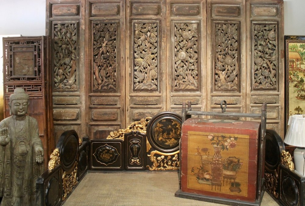 Back: a set of 6 antique door panels from Teochew. Front: a black lacquered Teochew daybed with gold gilt decorations.