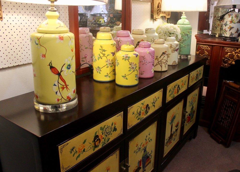 A assortment of colourful painted tea leaf jars