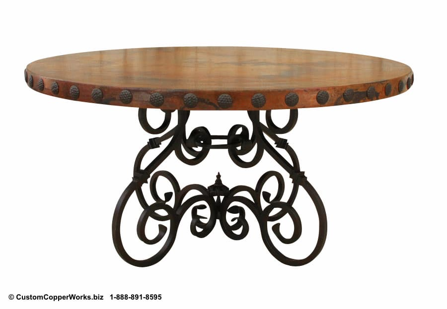 RUSTIC, ROUND, COPPER DINING TABLE: 60 inch round copper table top with decorative conchas (rivets) mounted on rustic, hand-forged, iron table base.