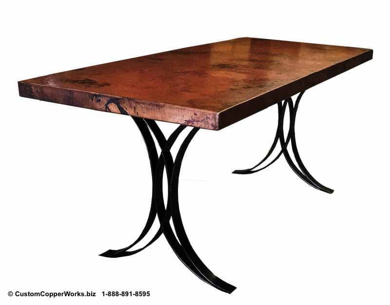 RECTANGLE, COPPER DINING TABLE: Copper top table mounted on thee  Justina , hand-forged, flat iron table base with flared legs.