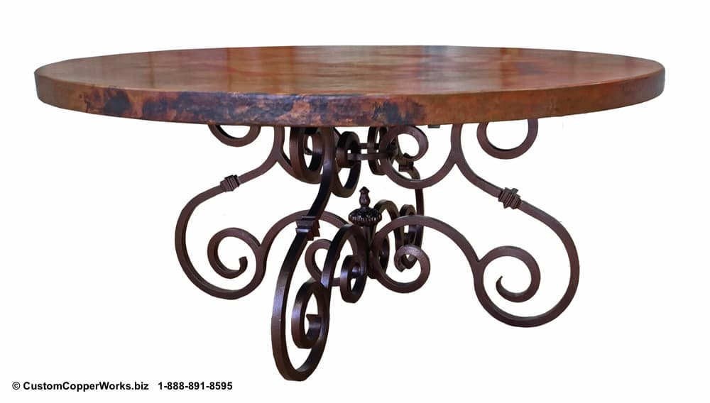 """COPPER DINING TABLE: 66"""" round copper table top mounted on hand-forged, French curl,  Canela  iron table base."""