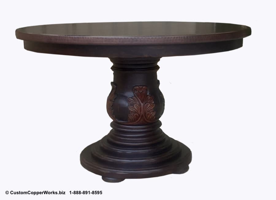 "Copper Round Dining Table – 48"" diameter mounted on single pedestal, wood table base with 3"" apron side drop and hand-carved detail."