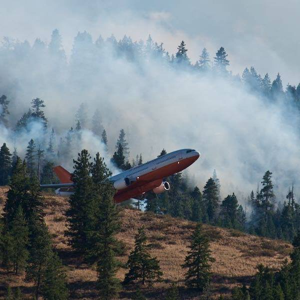 Fighting the fire, dropping fire retardant.