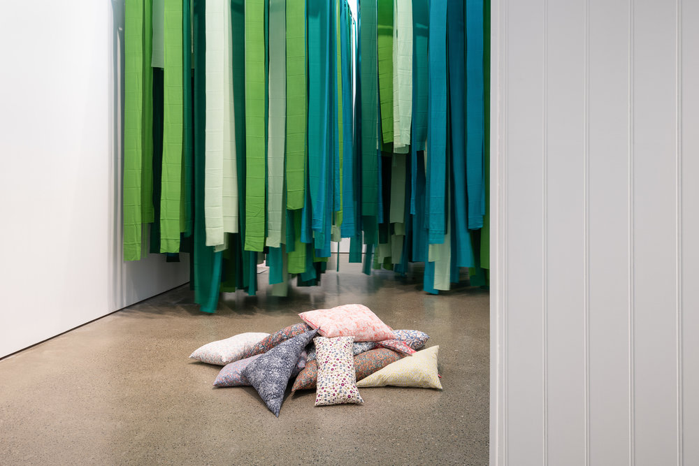 Element 1 (green canopy);  silk, powder coated steel (Foreground)  Mobile Element - Cushions for arranging, and sitting or lying on;  fabric, cushion filler Caoimhe Kilfeather Photo by Jed Niezgoda