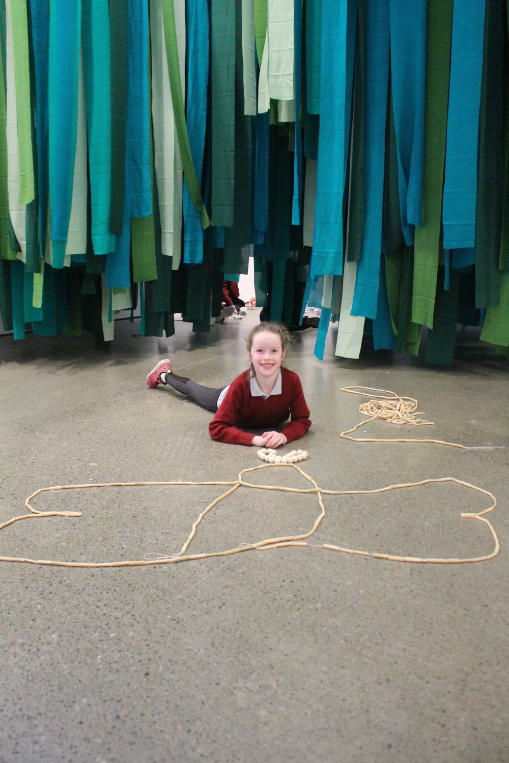 Drawing on the floor with a beaded line, one of the 'mobile elements' in Caoimhe Kilfeather's body of work