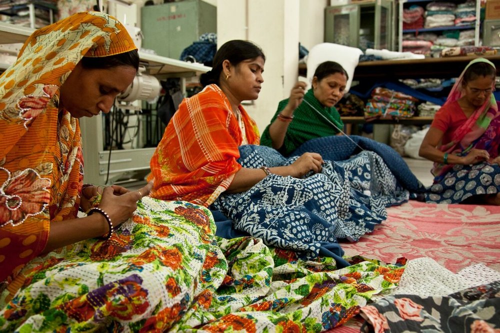 Women learning to sew at the Ladli charity